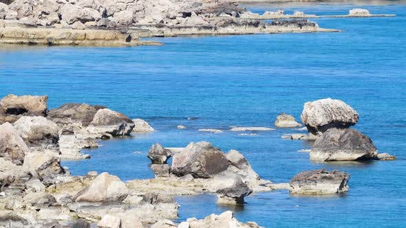 Large Stones in the Middle of Blue Sea Water Landscape Footage of Ocean Blue Water and Rocks Sunny