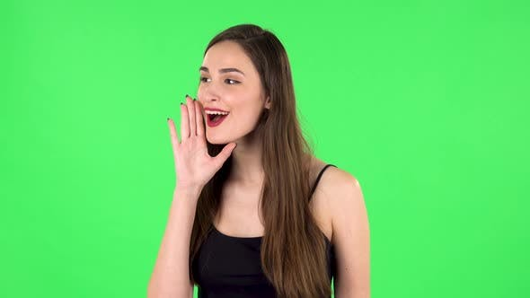 Thumbnail for Girl Screams Calling Someone on a Green Screen at Studio