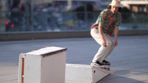 Active Skateboarder Sliding on Ledge Outdoors
