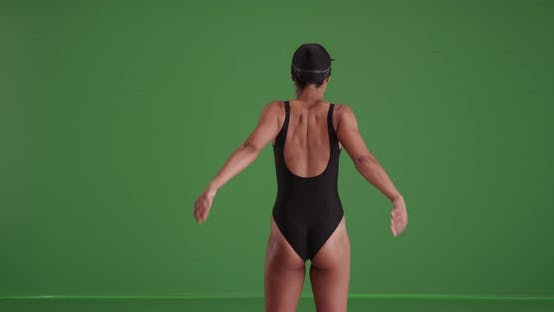 Thumbnail for Millennial mixed race woman swimmer stretching on green screen
