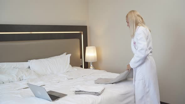 Business Lady Checked Into a Hotel Room.