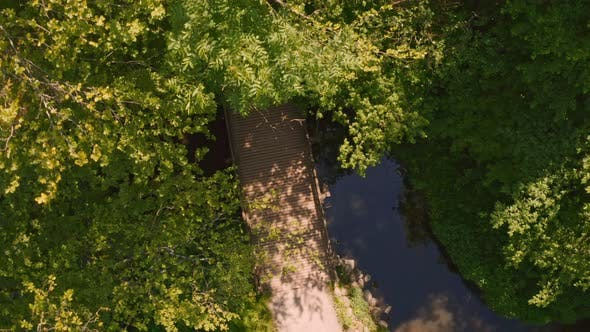 Thumbnail for Cyclist Riding Through Field, Drone Shot Of Cyclist Riding Over Bridge