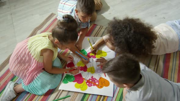 Thumbnail for Little Kids Drawing on Handmade Poster in Kindergarten