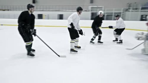 Ice Hockey Team Practicing in Rink
