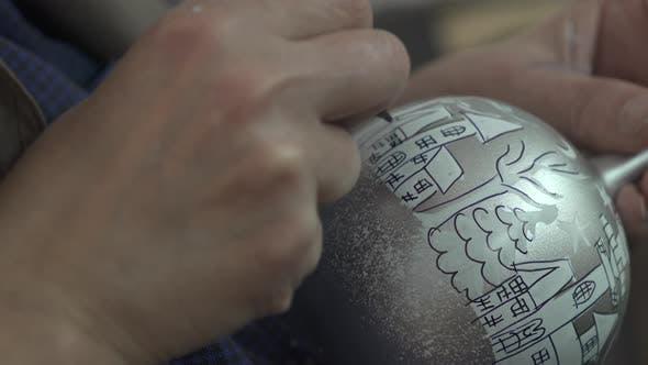 Drawing on a glass festive globe