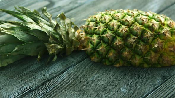 Thumbnail for Half of Pineapple on Wooden Table