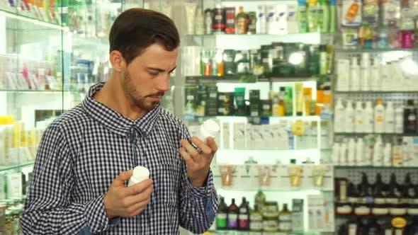 Thumbnail for Man Hesitating Between Two Drugs