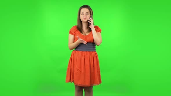 Thumbnail for Cute Girl Angrily Speaking on the Phone, Proving Something . Green Screen