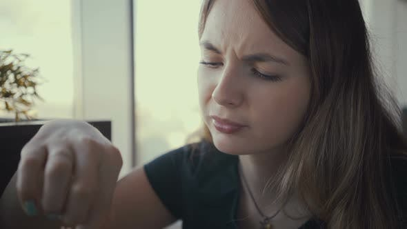 Thumbnail for Footage Young Woman Eating Tasty Burger in Fast Food Restaurant