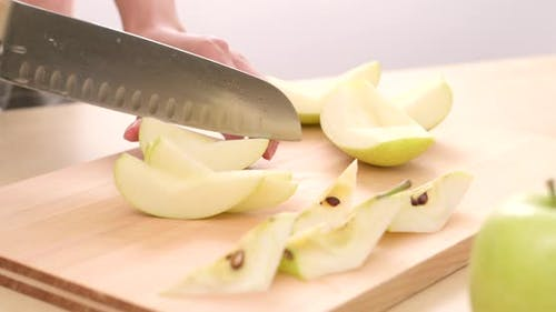 Cutting apple on the cutting board