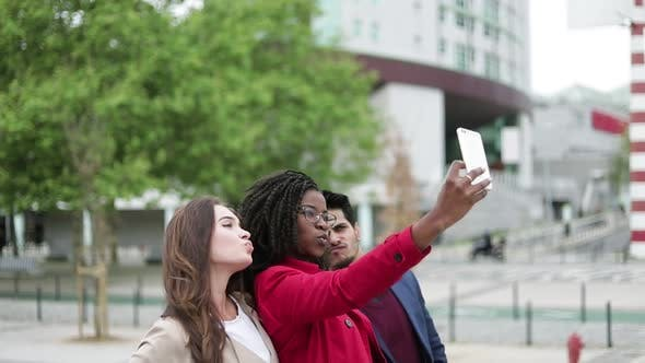 Thumbnail for Women and Man Making Selfie Outside, Posing, Smiling