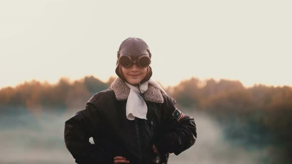 Thumbnail for Beautiful Portrait of Little Girl in Old Pilot Flight Jacket and Glasses on Sunset