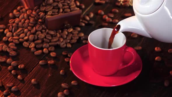 Cup of Hot Espresso in a Red Cup and Saucer