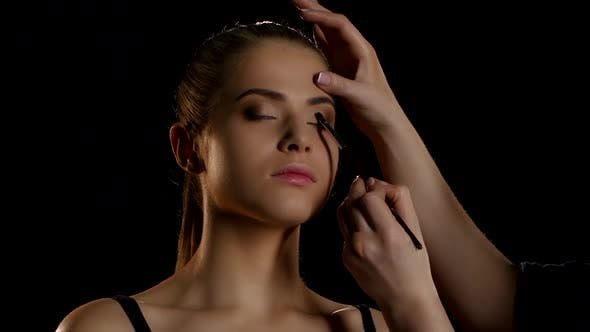 Thumbnail for Professional Make-up Artist Feathering Light Eyeshadow on the Eyelid. Close-up