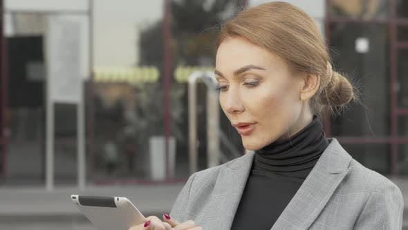 Thumbnail for Attractive Businesswoman Using Digital Tablet Outdoors