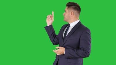 Meteorologist forecasting on a Green Screen, Chroma Key.