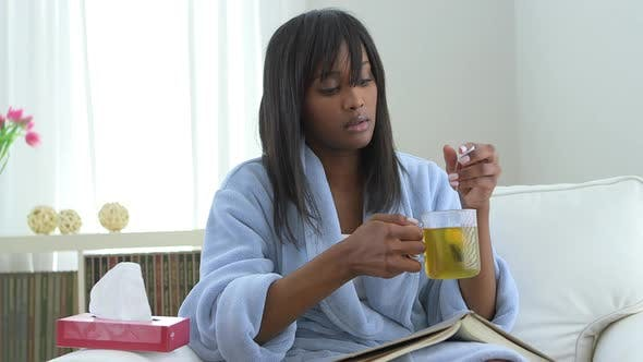Thumbnail for Black woman with flu drinking tea