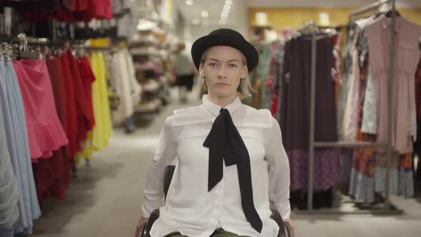 Thumbnail for Independent Woman in Wheelchair in Clothing Store