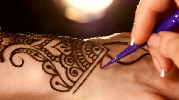 Thumbnail for Process of Applying Mehndi on Hand Close Up, Back Light, Black