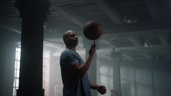 Guy Spinning Basketball Ball on Finger