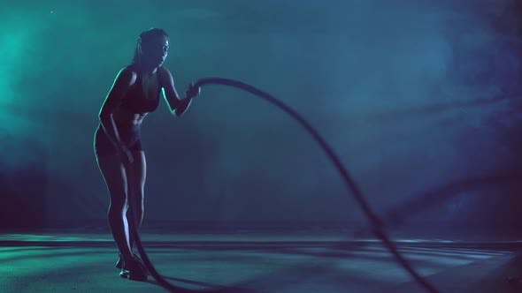 Thumbnail for Muscular Brunette Woman Training with Ropes.