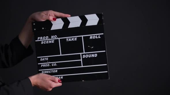 Thumbnail for Clapper Board in Action on a Gray Background