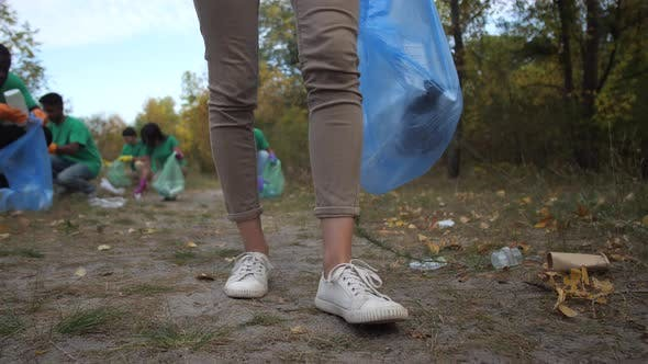 Thumbnail for Legs of Woman Volunteer Picking Up Plastic Trash