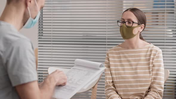 Thumbnail for Doctor Checking Medical History with Patient