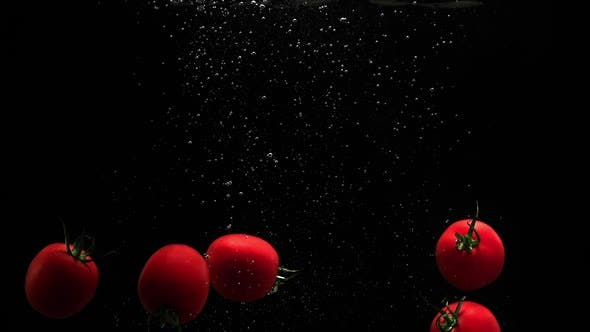 Cover Image for Red Ripe Tomatoes Falling In Water With Air Bubbles Splash And Droplets