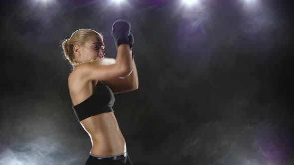 Thumbnail for Woman Boxer Makes the Punching and Kicking. Close Slow Motion