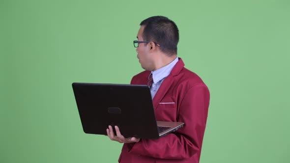 Thumbnail for Happy Asian Businessman Using Laptop and Watching Adult Videos