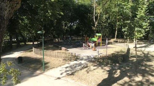 No Kids swinging and playing at park