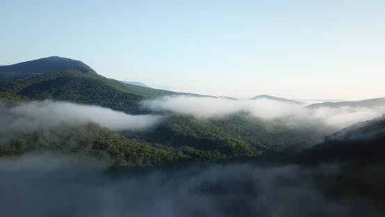 Thumbnail for Epic Aerial Flight Over Clouds Mist Forrest Sunset