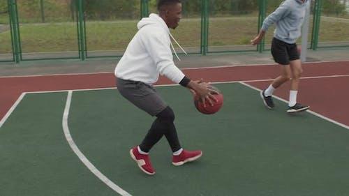 Guys Playing Streetball on Basketball Court