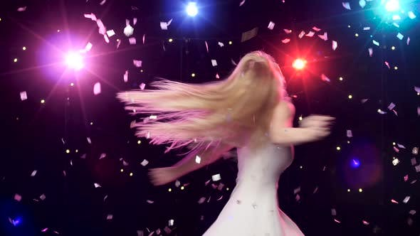 Thumbnail for Carefree Girl Are Dancing Against Disco Lights and Glitter Confetti