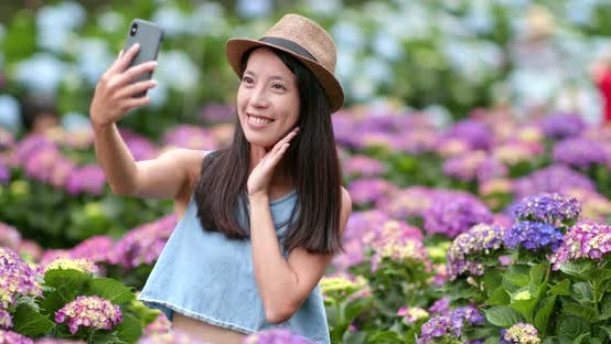 Thumbnail for Woman taking self vlog on cellphone and talking to camera