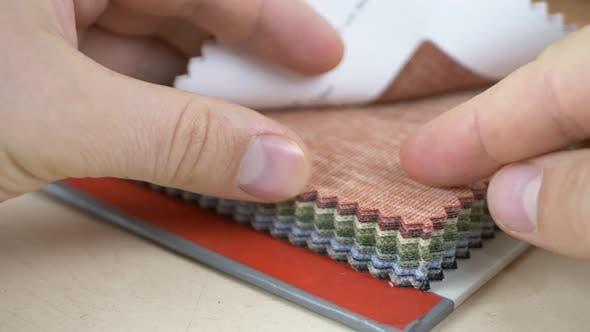 Fashion Designer Chooses Fabric Samples