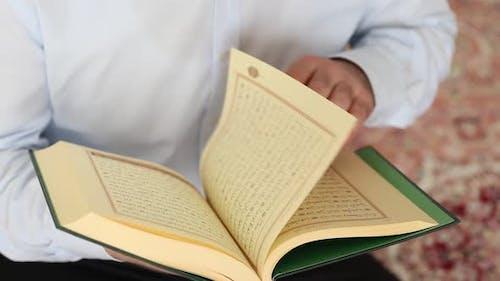 Reading Quran in Islam Mosque