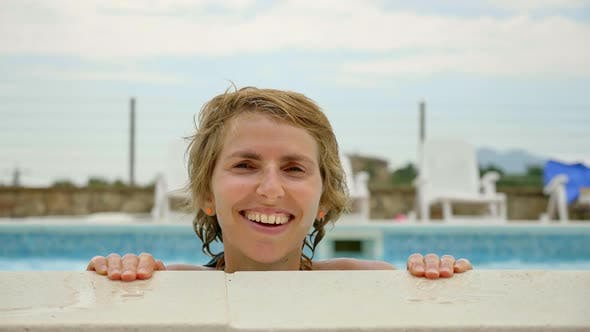 Cover Image for Girl Smiling at the Camera While in the Pool