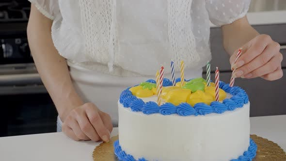 Cover Image for Attractive Woman Preparing A Birthday Cake