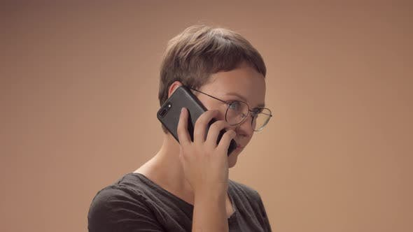 Caucasian Woman in Studio Talking on the Mobile Phone