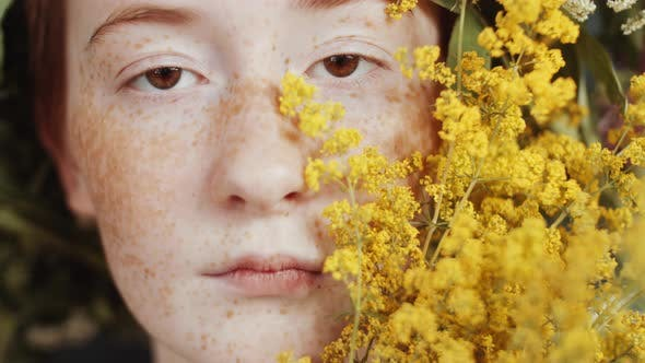 Thumbnail for Portrait of Girl with Yellow Wildflowers