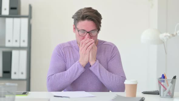 Thumbnail for Middle Aged Man Sneezing in Office