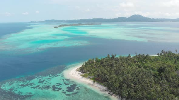 Thumbnail for Aerial: flying over tropical island white beach caribbean sea turquoise water coral reef Indonesia
