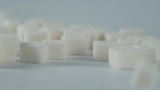 Sugar Cubes Fall on the Table