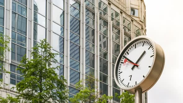 Time Lapse of Clock and Office Building