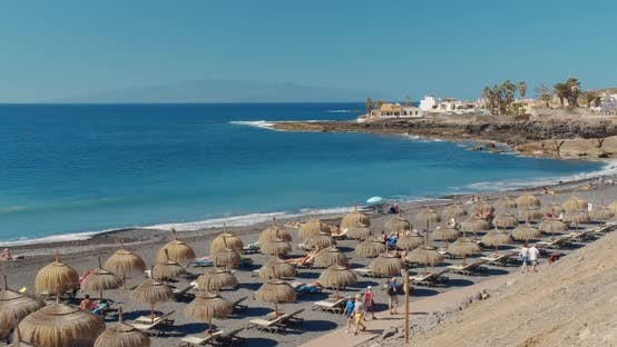 Summer Beach with Umbrellas and Turquoise Ocean Water From. Beach on a Sunny Day in Tenerife, Spain
