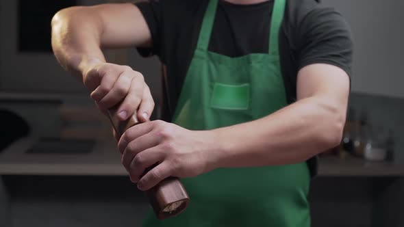 Thumbnail for Chef Uses Salt Mill To Add Some Salt for His Meal, Salt Falls in Slow Motion, Milling the Salt