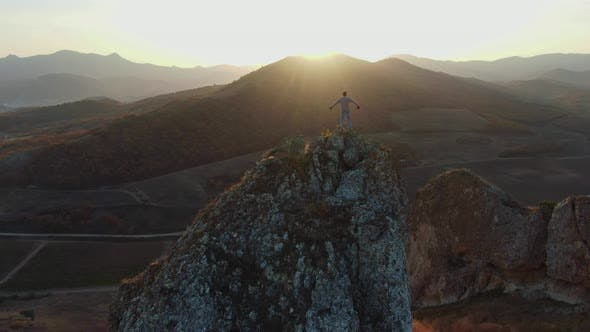 Men Climbed To the Top of the Mountain To Enjoy the Sunset Man Stands Against the Beautiful