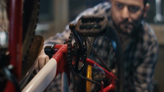 Thumbnail for Man Repairing a Bicycle in a Garage